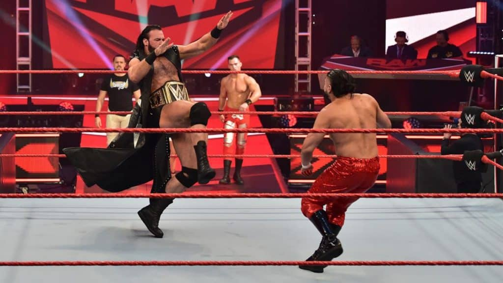 Drew McIntyre Claymore's Andrade while Vega Theory and Garza look on