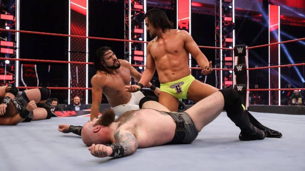 Tensions between Andrade and Garza with Erik on the mat