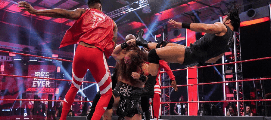 Drew McIntyre Claymore's Lashley while the Street Profits try to drag him off Ivar