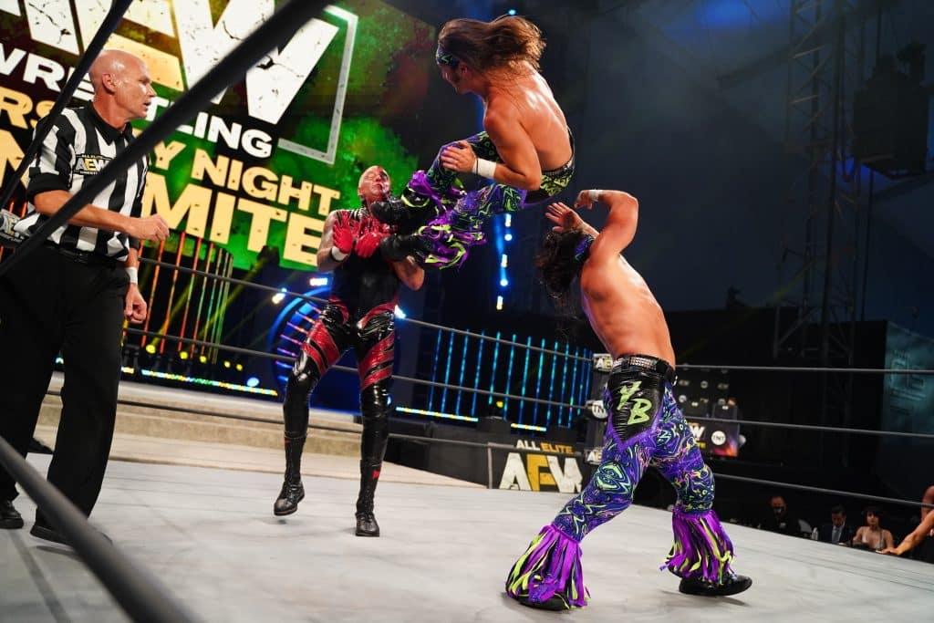 Matt Jackson helps his brother Nick hit a dropkick onto Dustin Rhodes