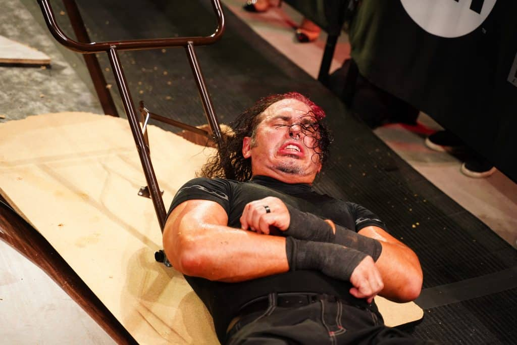Matt Hardy in agony after being put through a table
