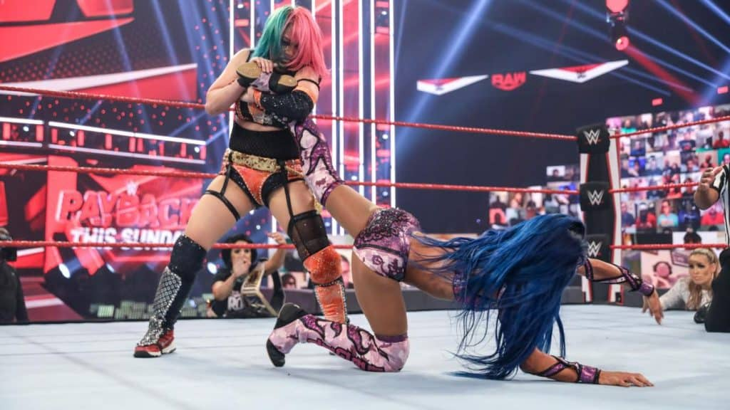 Asuka with Sasha Banks in an ankle lock