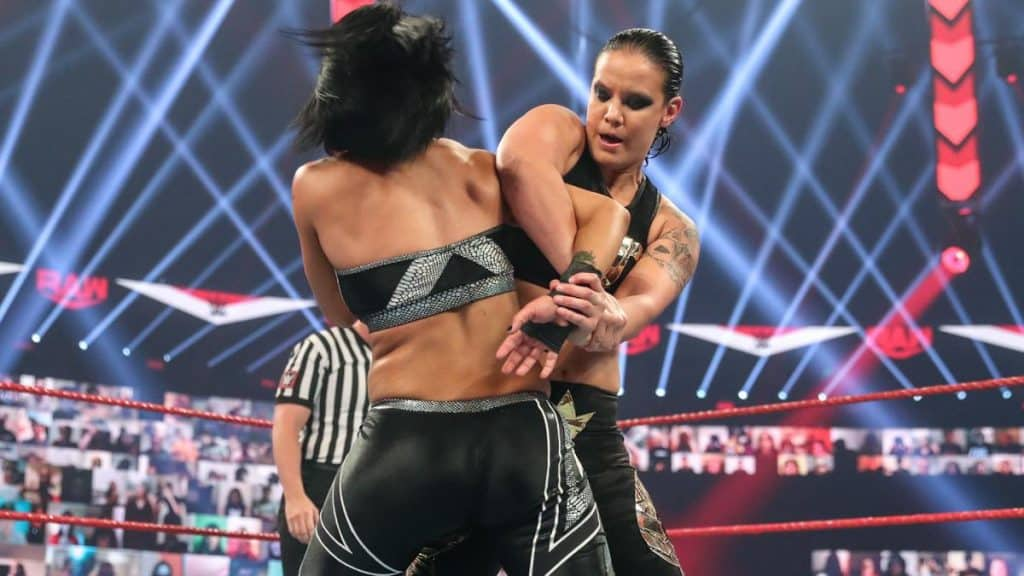 Shayna Baszler bends Bayley's arms back