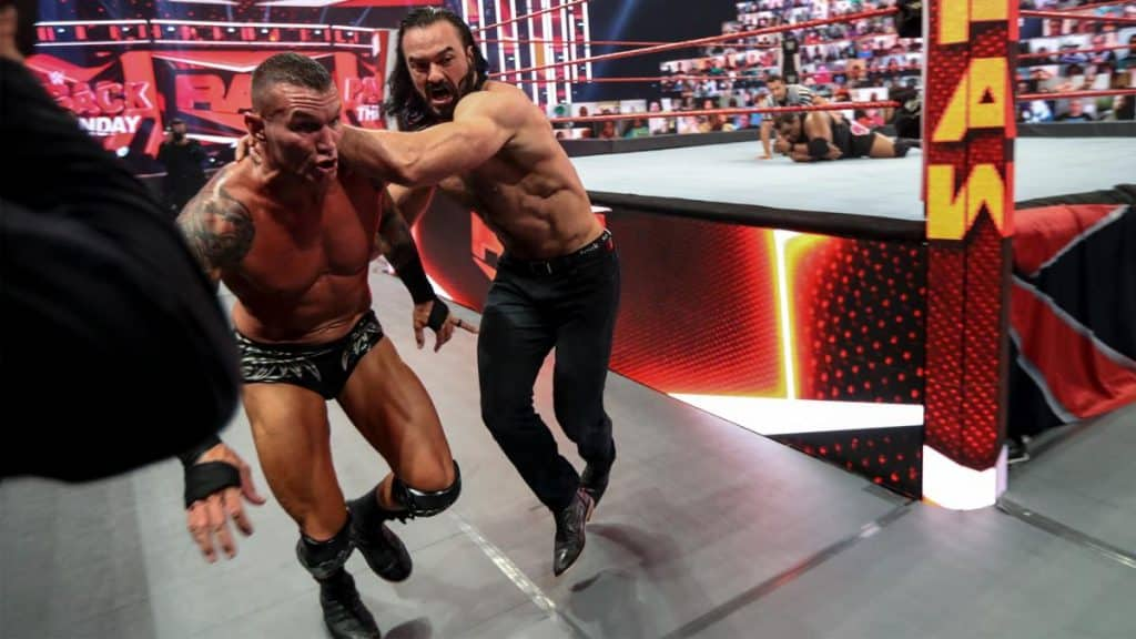 Drew McIntyre throws Randy Orton