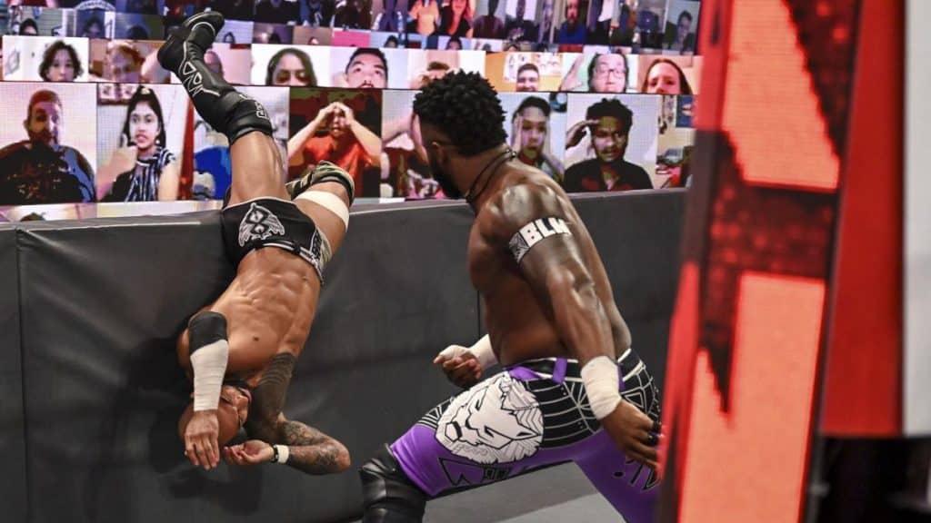 Cedric Alexander throws Ricochet into the barricade