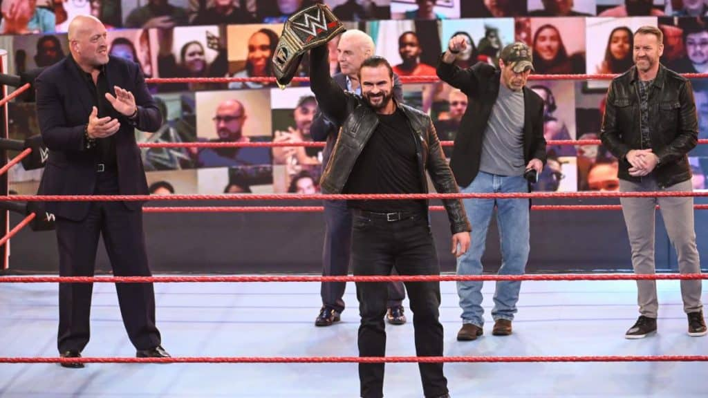 Drew McIntyre holds the title up with Shawn Michaels, Ric Flair, Christian, and Big Show