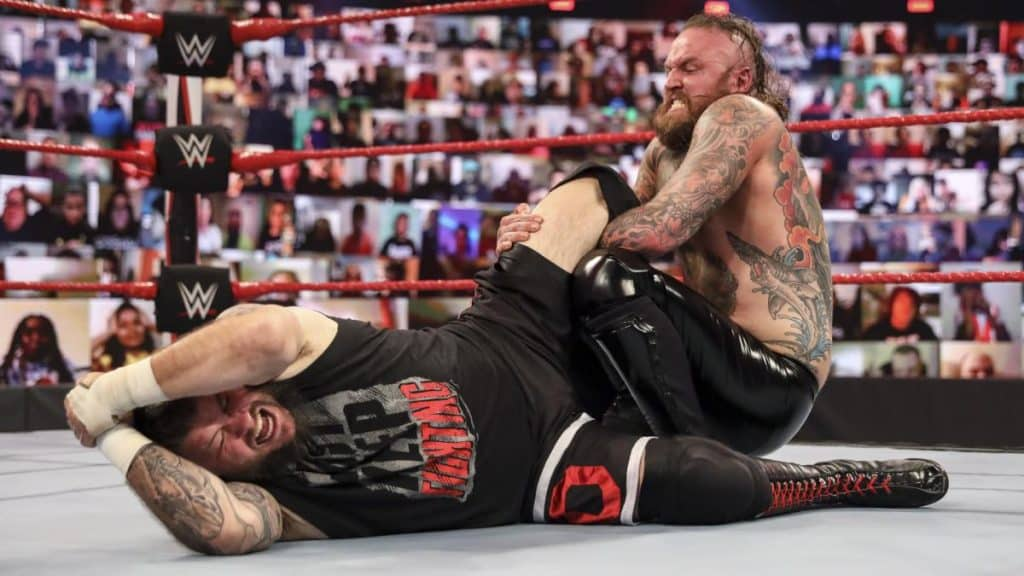 Aleister Black tries to submit Kevin Owens