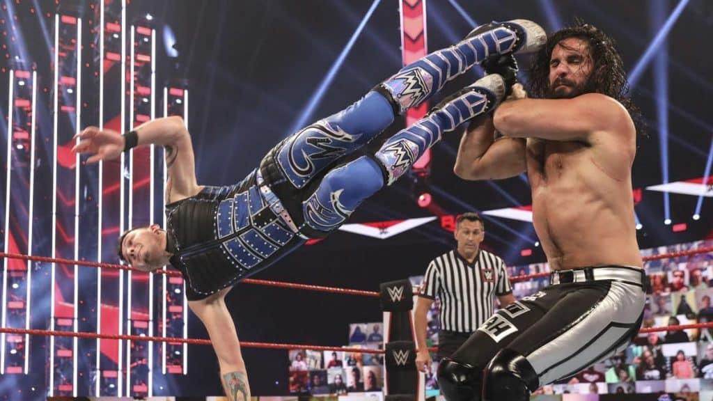 Dominik Mysterio dropkicks Seth Rollins