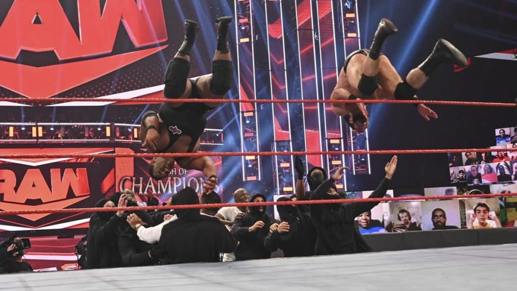 Drew McIntyre and Keith Lee somersault over the top rope onto RETRIBUTION and The Hurt Business