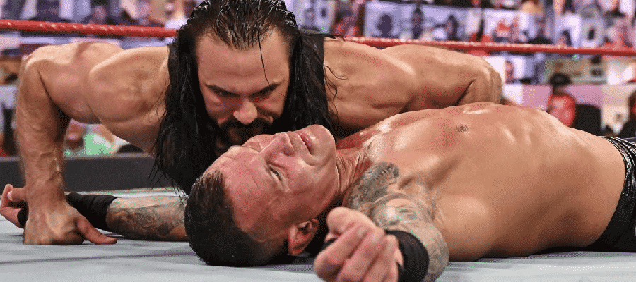 Crew McIntyre leans over Randy Orton