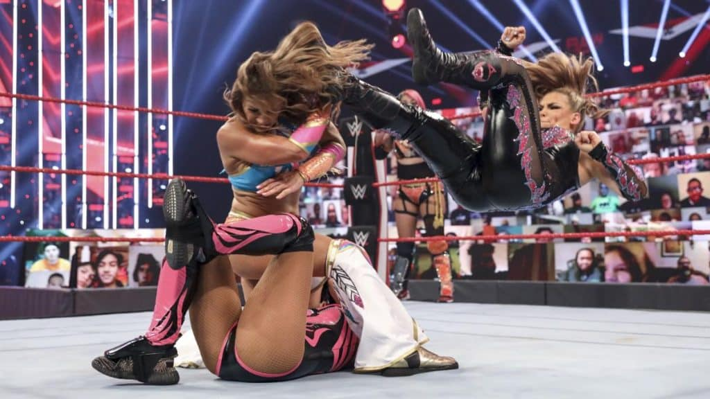 Natalya dropkicks Micke James to make her release Lana
