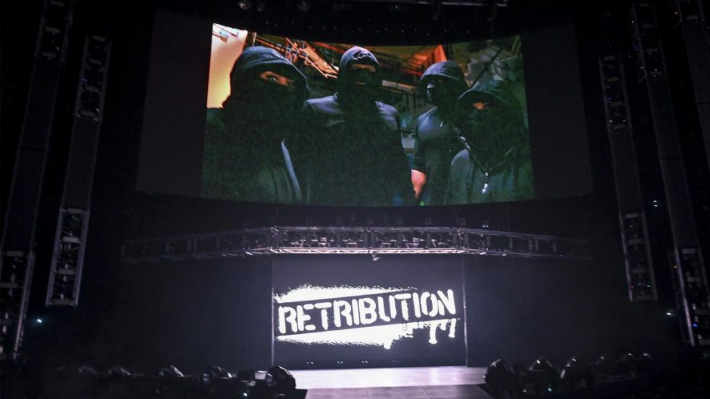 RETRIBUTION on the big screen with their logo below