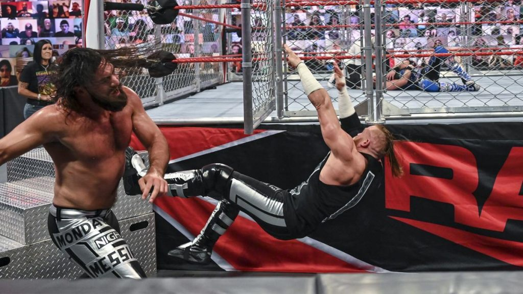 Seth Rollins smacks Murphy in the face with the cage door