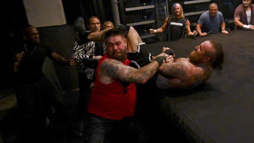 Kevin Owens drags Aleister Black off the RAW Underground platform
