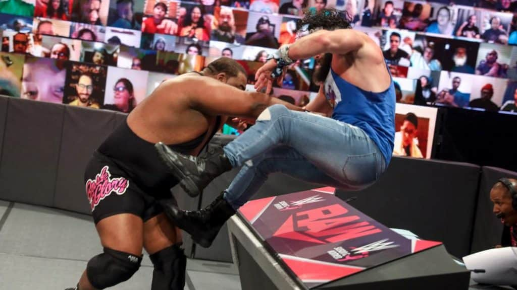Keith Lee pounces Elias over the announce desk