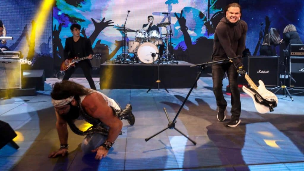 Elias narrowly avoids a guitar swung by Jeff Hardy