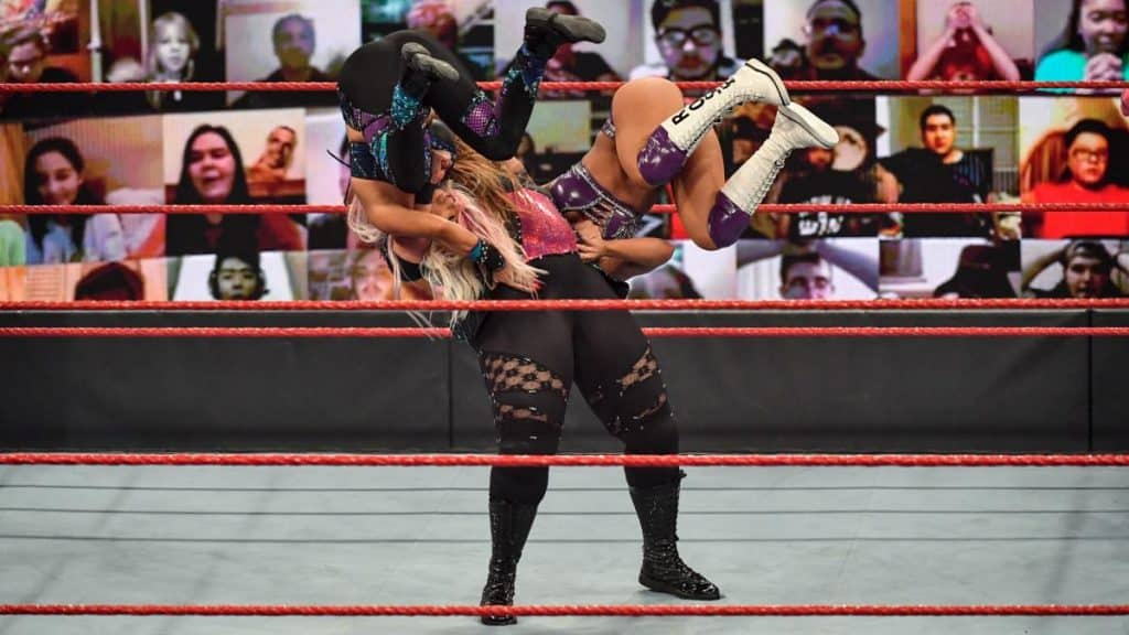 Nia Jax suplexes Dana Brooke and Mandy Rose