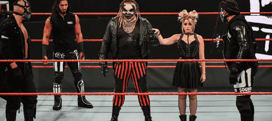 Alexa Bliss and The Fiend are surrounded by RETRIBUTION
