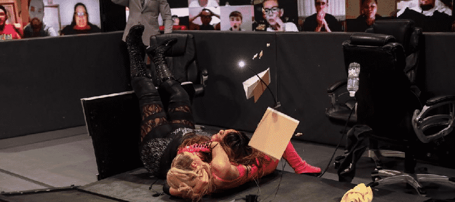Nia Jax puts Lana through the announce desk again.