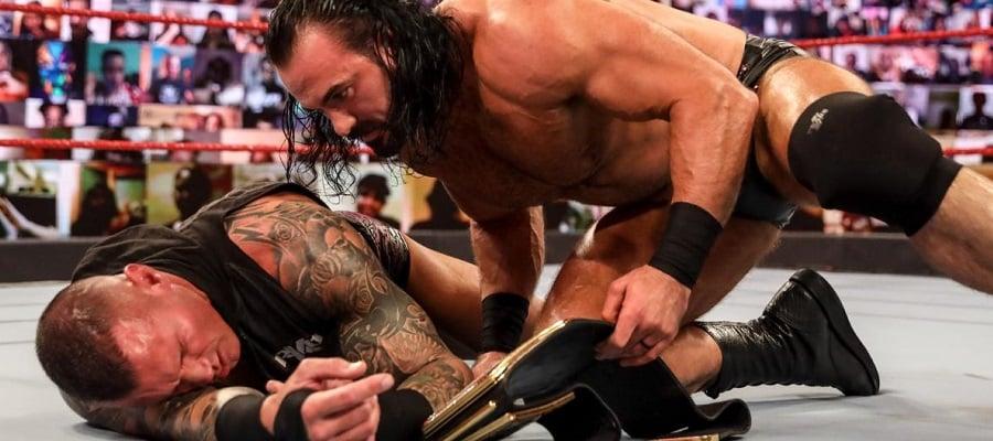 Drew McIntyre leans over Randy Orton