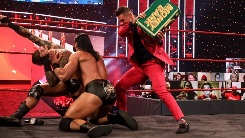 The Miz hits Drew McIntyre with the MITB briefcase