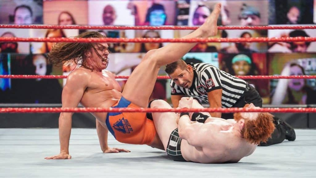 Riddle tries to break Sheamus' submission