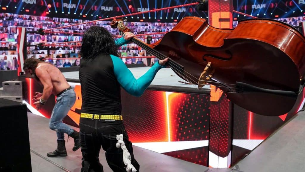 Jeff Hardy swings a double bass at Elias