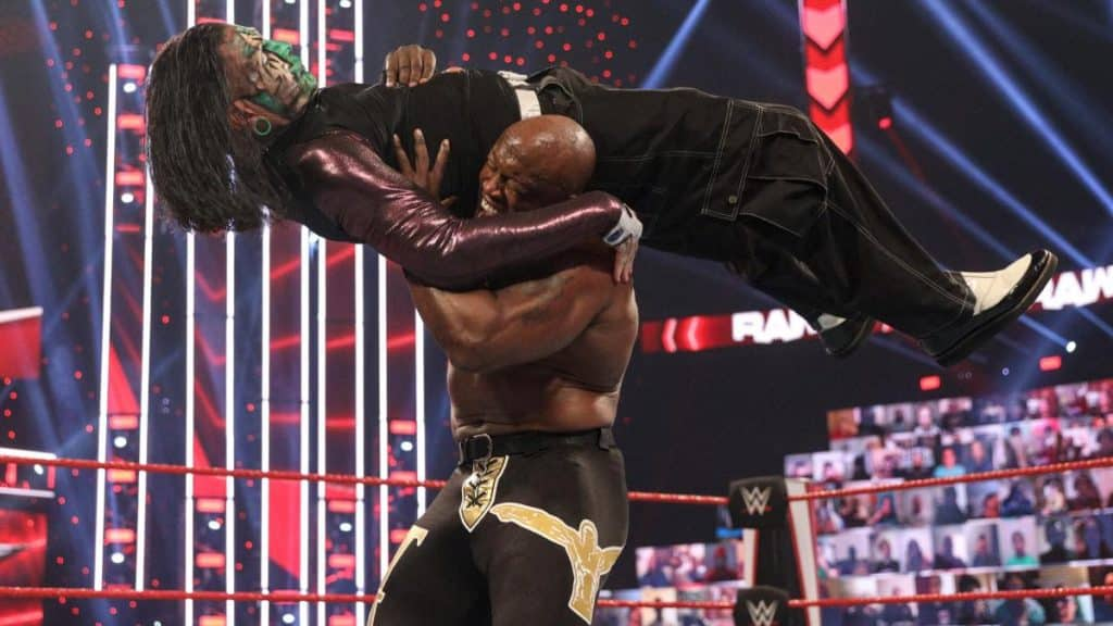 Bobby Lashley with Jeff Hardy on his shoulder