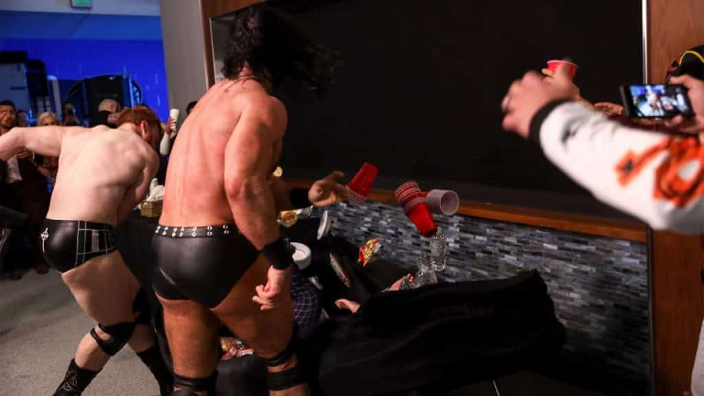 Sheamus and Drew McIntyre put Pat Buck through a snack table