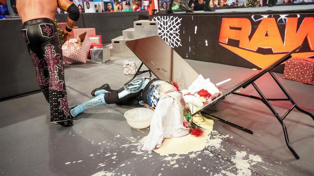 AJ Styles covered in eggnog