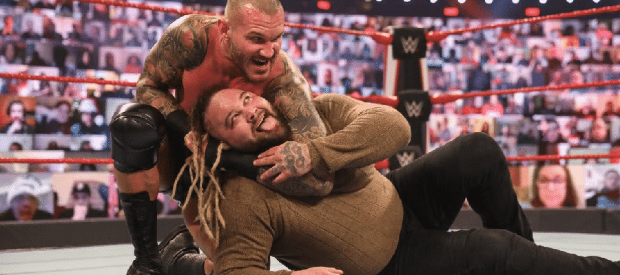 Randy Orton with Bray Wyatt in a headlock