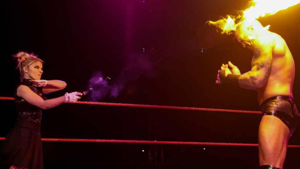 Alexa Bliss throws a fireball at Randy Orton