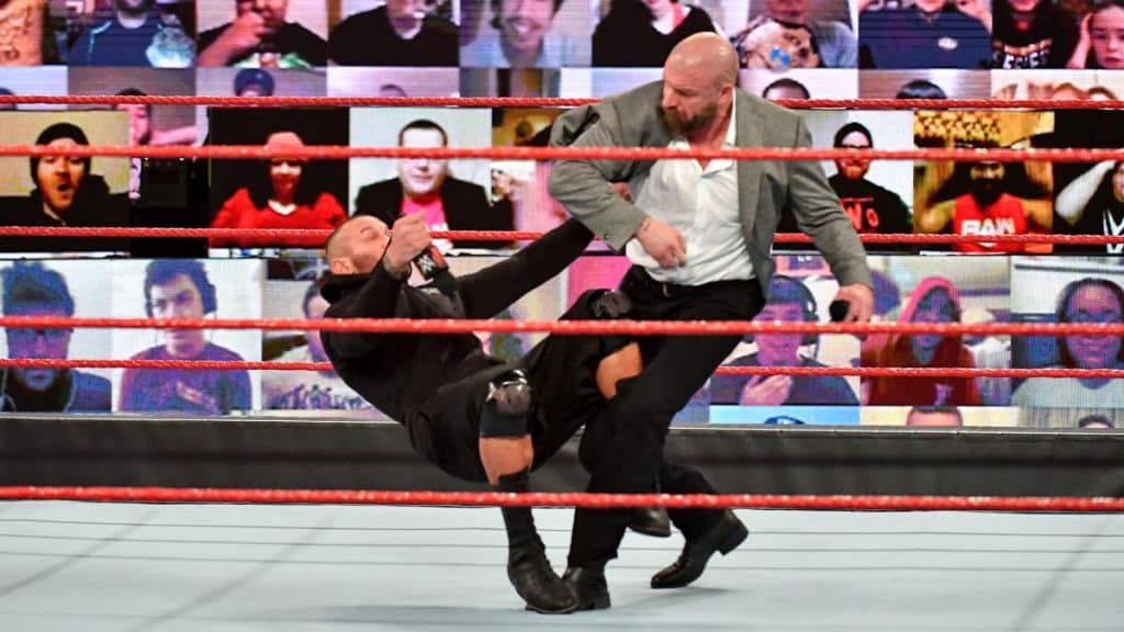 Triple H punches Randy Orton