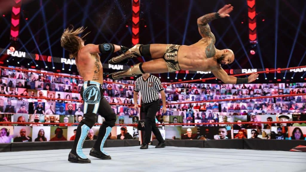 Ricochet dropkicks AJ Styles