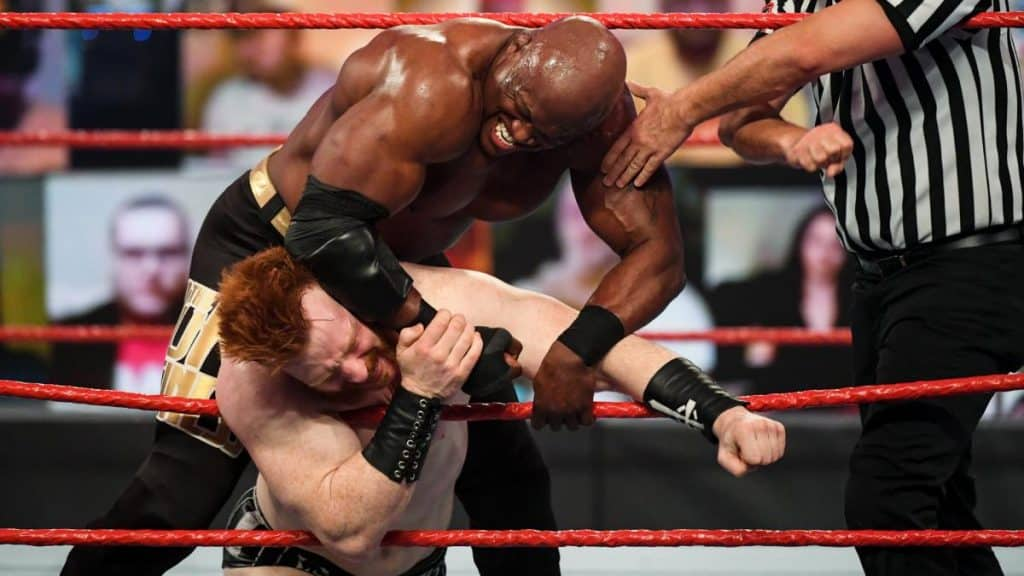 Bobby Lashley shoves Sheamus onto the ropes