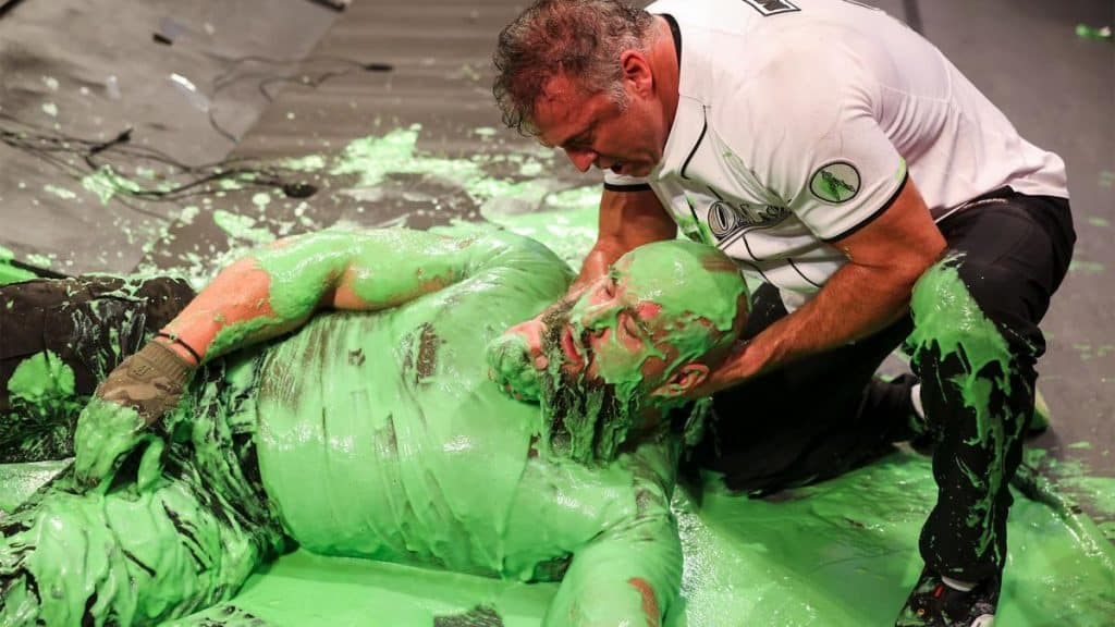 Shane McMahon, and Braun Strowman covered in green goo