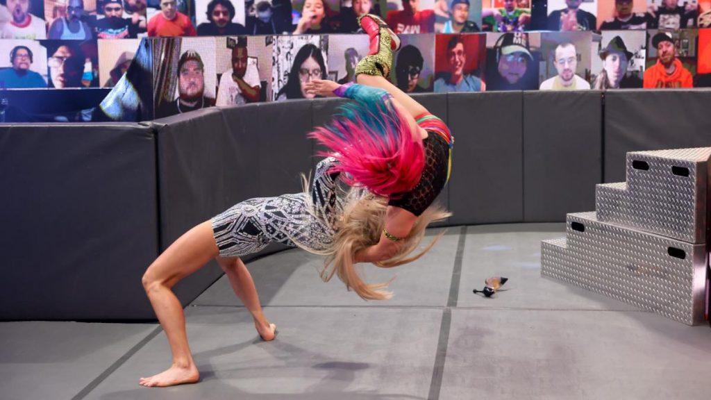 Charlotte Flair suplexes Asuka