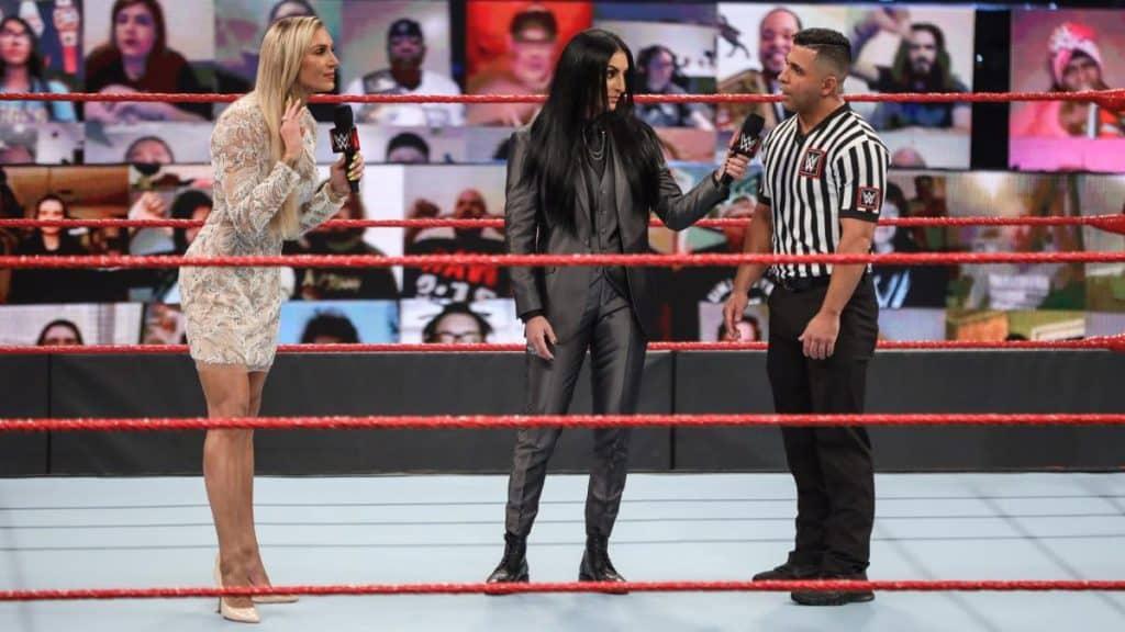 Charlotte Flair, Sonya Deville, and Eddie Orengo