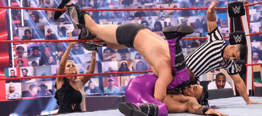 Miz pins Priest with his feet on the ropes while Maryse helps