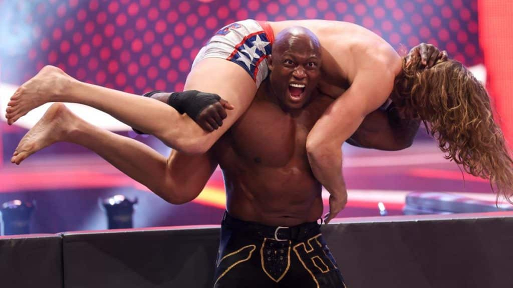 Lashley with Riddle on his shoulders