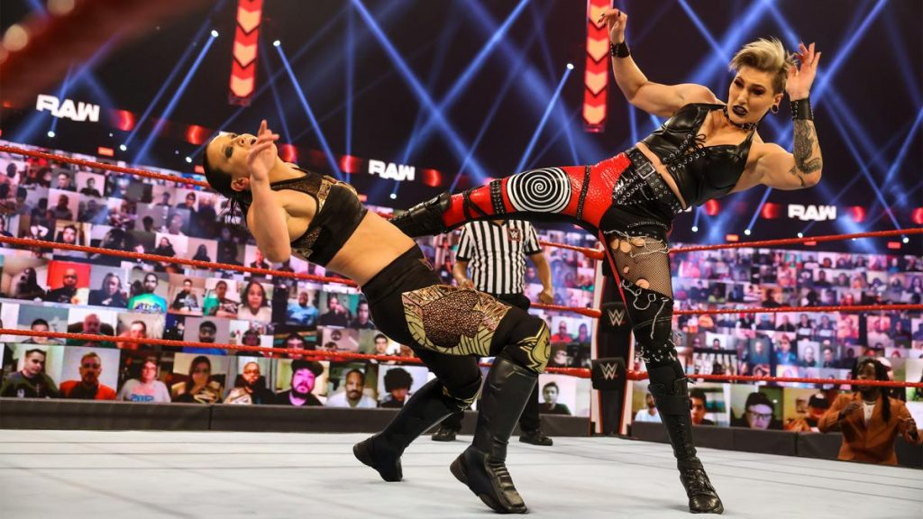 Rhea Ripley kicks Shayna Baszler in the face