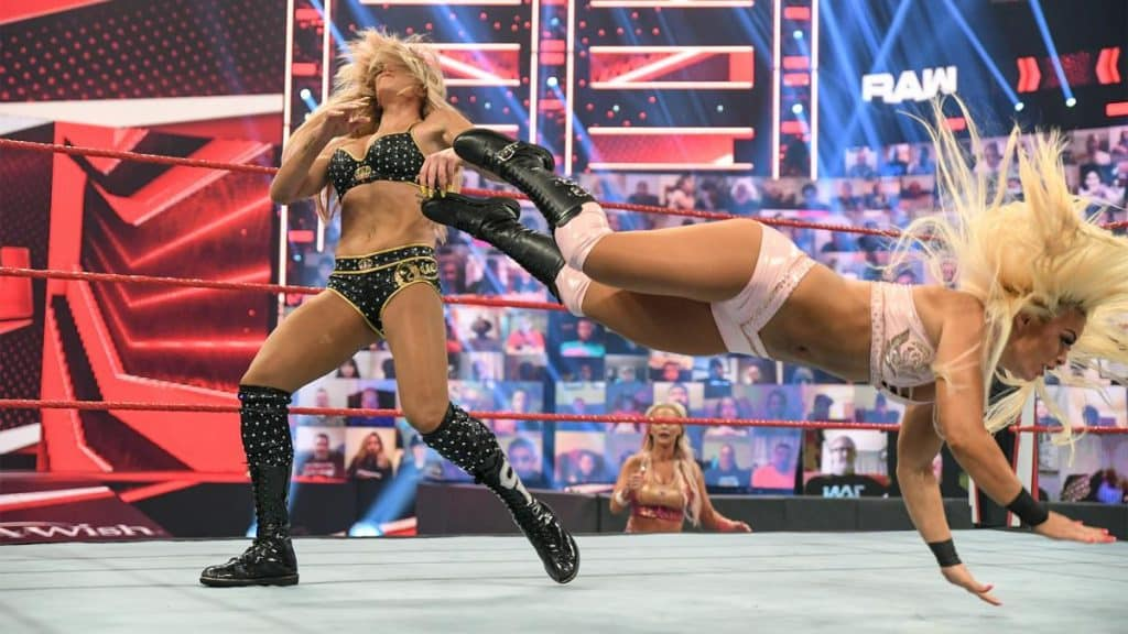 Mandy Rose dropkicks Charlotte Flair