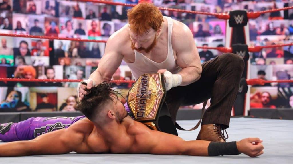 Sheamus kneels over Humberto Carrillo