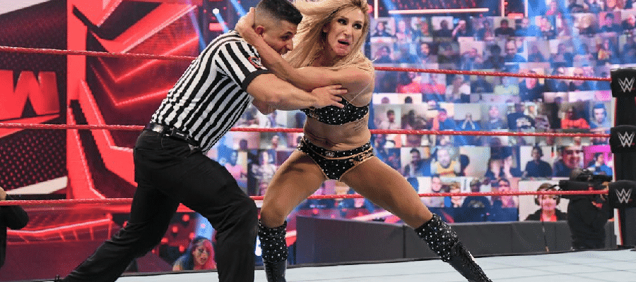 Charlotte Flair throws a referee