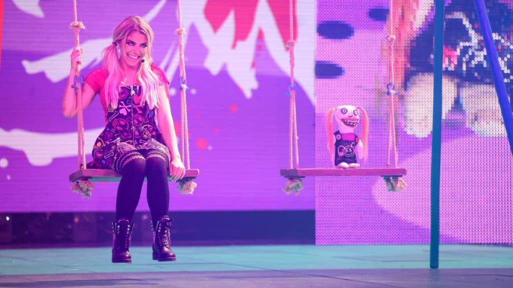 Alexa Bliss and Lilly on a swingset