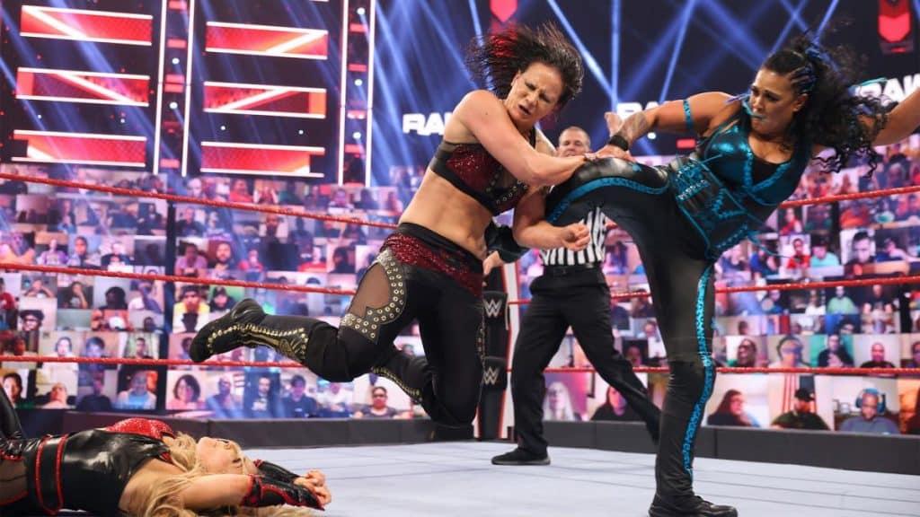 Tamina kicks Shayna Baszler
