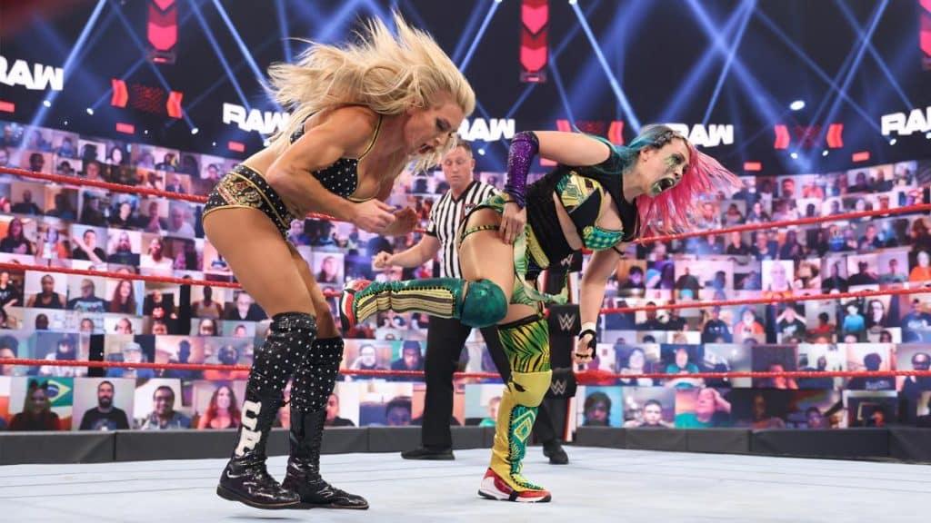 Asuka kicks Charlotte Flair