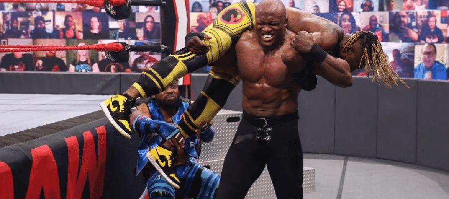 Xavier Woods pulls Kofi Kingston off Bobby Lashley's shoulders