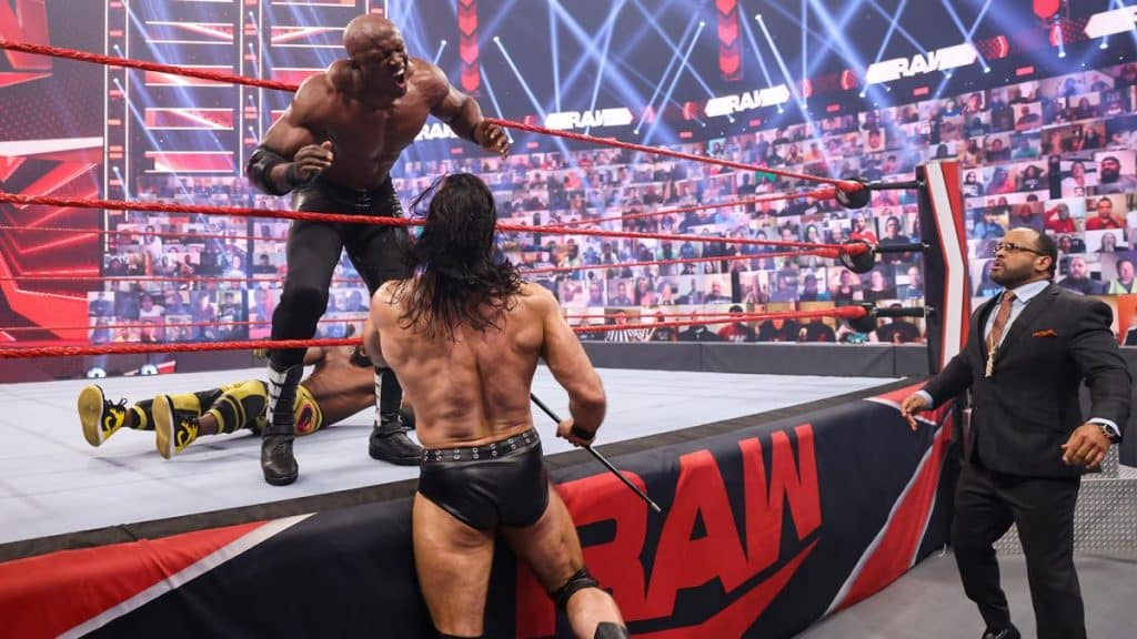 Drew McIntyre hits Bobby Lashley in the gut with MVP's walking cane
