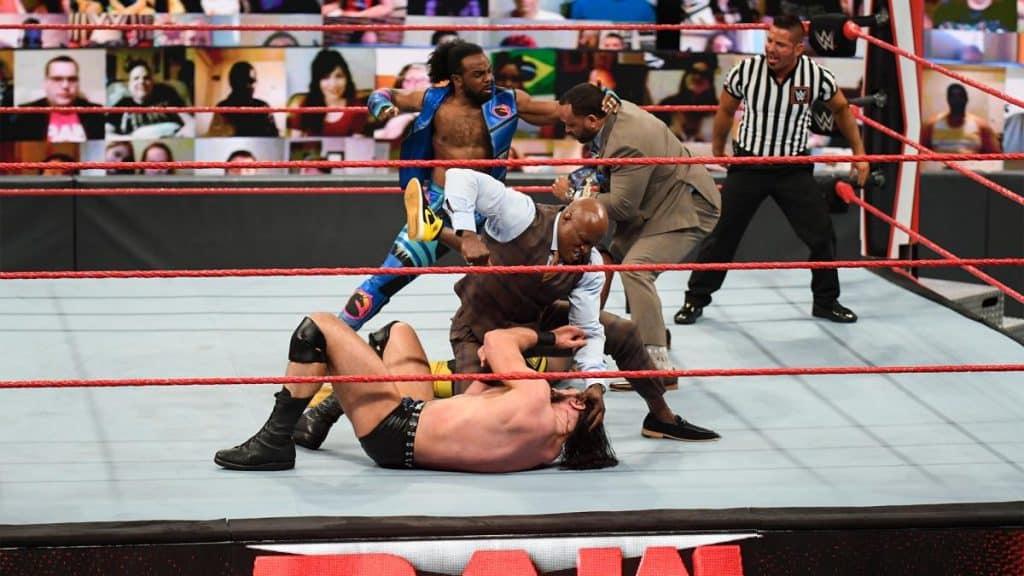 Xavier Woods tries to protect Kofi Kingston from MVP while Bobby Lashley beats on Drew McIntyre